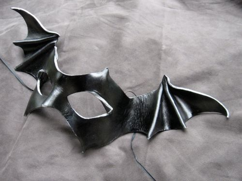 A bat-winged mask in black leather
